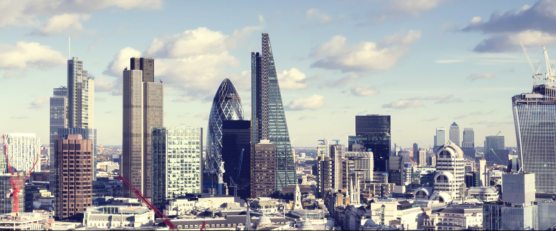 London skyline with the landmark corporate buildings of the City of London and Canary Wharf.