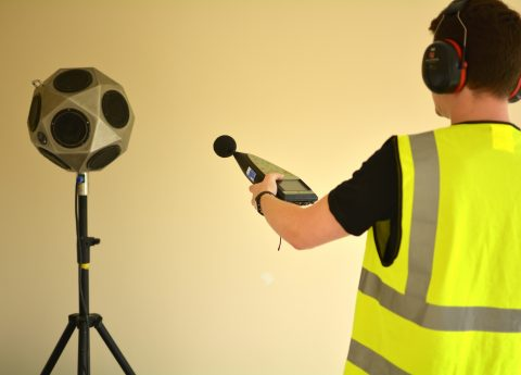 Staff member conducting a sound test for building regulations